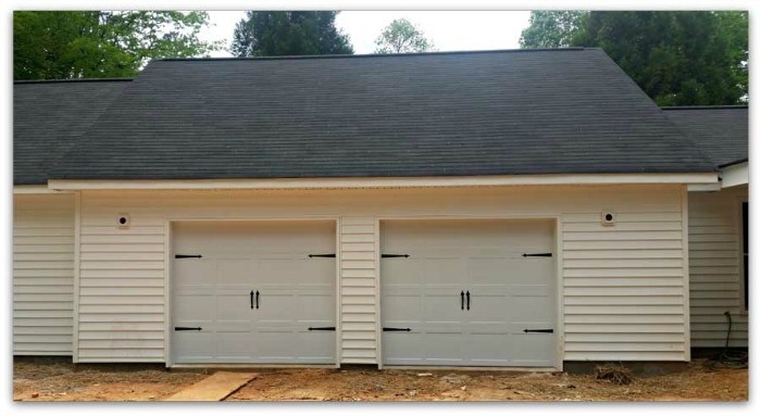White Sided Double Garage, New Construction.