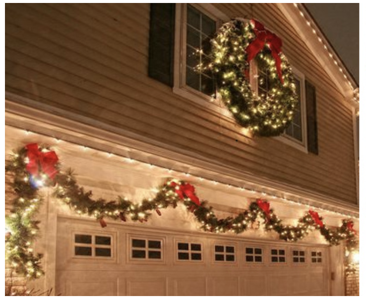 Lights and wreaths on this door