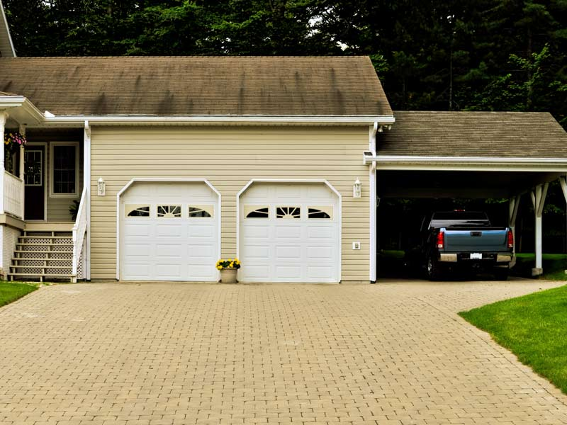 Carport juxtaposed to Garage